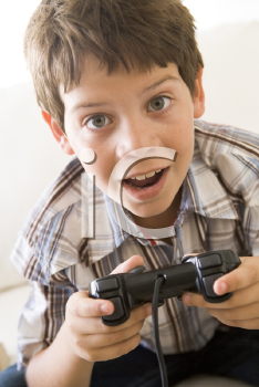 Royalty Free Photo of a Young Boy With a Video Game Controller