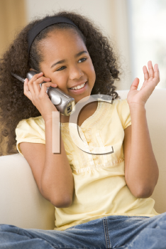 Royalty Free Photo of a Girl With a Cellphone