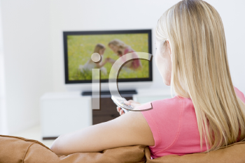 Royalty Free Photo of a Woman Watching Television