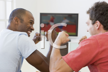 Royalty Free Photo of Two Men Watching Soccer