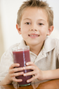 Royalty Free Photo of a Boy With Juice