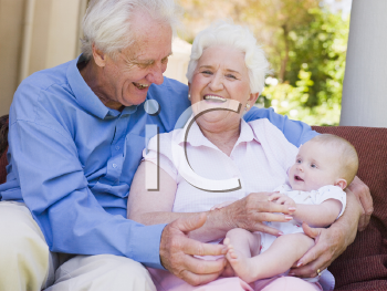 Royalty Free Photo of Grandparents With a Baby