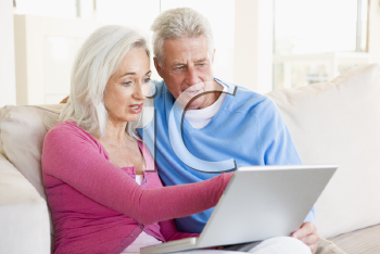 Royalty Free Photo of a Couple at Home With a Laptop
