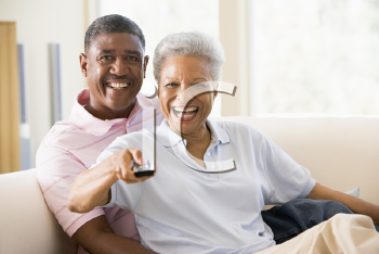 Royalty Free Photo of a Couple Watching Television