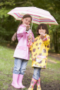 Royalty Free Photo of Two Little Girls With Umbrellas