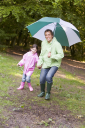 Royalty Free Photo of a Father and Daughter With an Umbrella