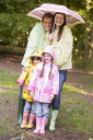 Royalty Free Photo of a Family in the Rain
