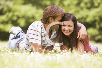 Royalty Free Photo of a Couple Lying in a Field