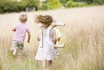 Royalty Free Photo of Children Running Outside