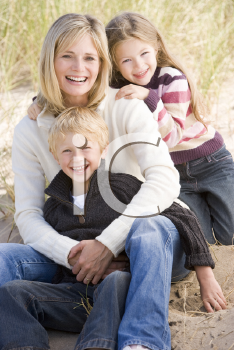 Royalty Free Photo of a Mother and Two Children at the Beach