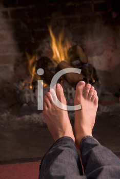 Royalty Free Photo of Feet Warming at a Fire
