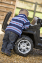 Royalty Free Photo of a Boy Fixing a Toy Jeep