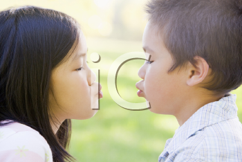 Royalty Free Photo of a Brother and Sister Making Faces