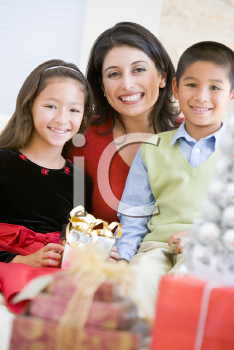 Royalty Free Photo of a Mother With Her Children at Christmas