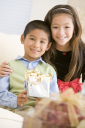 Royalty Free Photo of a Brother and Sister With Gifts