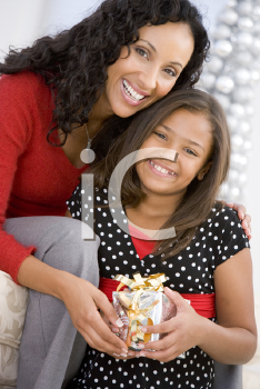 Royalty Free Photo of a Mother and Daughter With a Gift