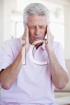 Royalty Free Photo of a Man With a Headache