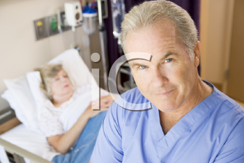Royalty Free Photo of a Doctor in a Patient's Room