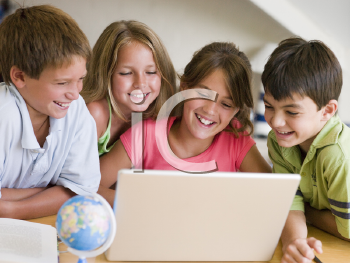Royalty Free Photo of a Group Of Children With a Laptop