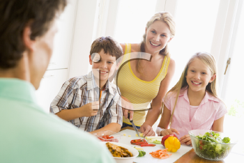 Royalty Free Photo of a Family Preparing a Meal