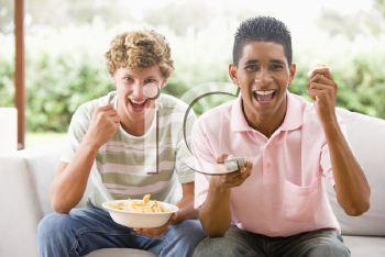 Royalty Free Photo of Teens Eating Chips