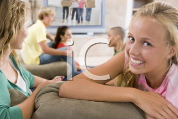 Royalty Free Photo of Teens Watching Television