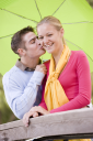 Royalty Free Photo of a Teenage Couple Kissing