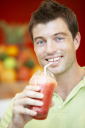 Royalty Free Photo of a Man Drinking a Berry Smoothie