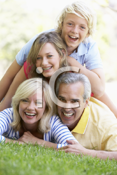 Royalty Free Photo of a Family Lying on the Ground