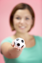 Royalty Free Photo of a Woman Holding a Soccer Ball