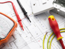 Royalty Free Photo of Electric Equipment on House Plans