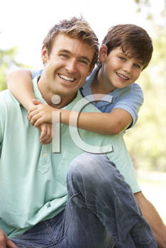 Royalty Free Photo of a Father and Son Outdoors