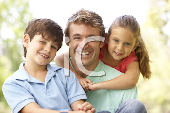Royalty Free Photo of a Father With a Son and Daughter