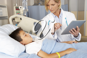 Doctor Using Digital Notepad Whilst Visiting Child Patient