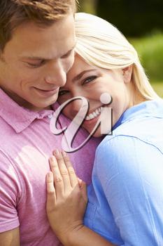 Romantic Young Couple Hugging In Garden