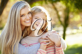 Portrait Of Mother And Daughter In Countryside