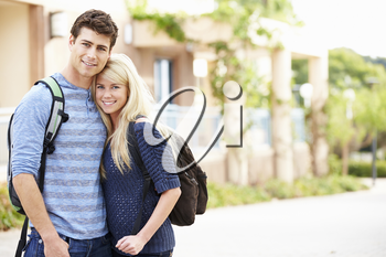 Portrait Of Student Couple Outdoors On University Campus