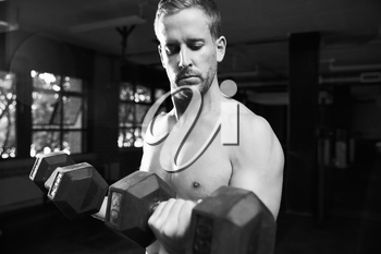 Black And White Shot Of Bare Chested Man Lifting Weights