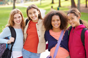Group Of Young Girls Hanging Out In Park Together