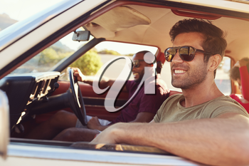 Two Male Friends Relaxing In Car During Road Trip