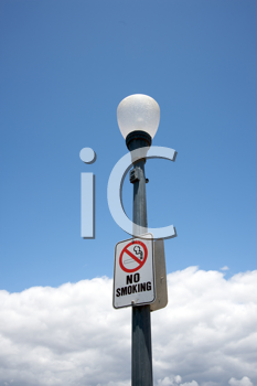 Royalty Free Photo of a No Smoking Sign on a Streetlight