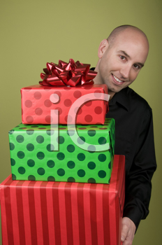 Royalty Free Photo of a Man Holding Presents