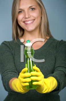 Royalty Free Photo of a Woman Holding Dish Soap