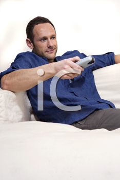 Royalty Free Photo of a Man With a Remote