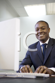 Royalty Free Photo of a Black Businessman on a Keyboard