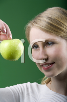 Royalty Free Photo of a Woman Holding an Apple