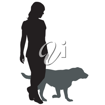 Silhouette of a woman with a dog on a walk