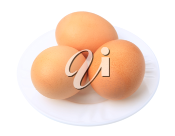 Three brown eggs on a white background, isolated.