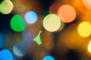 xmas wallpaper of blurred spot of lights, cityscape at night