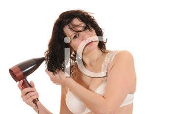 Royalty Free Photo of a Woman Using a Hairdryer